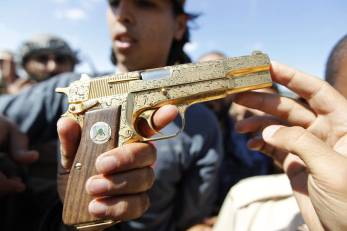 Gadaffi's Hi-Power, flourished with typical Libyan gun-handling skill.